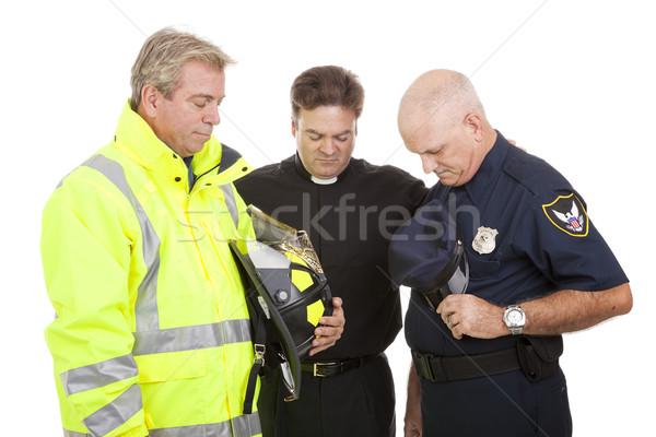молиться работу министр пожарный полицейский изолированный Сток-фото © lisafx