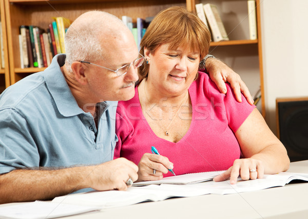 Mature Couple Studies in Library Stock photo © lisafx