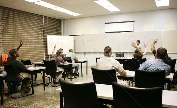 Felnőtt kezek kiemelt felnőttoktatás osztály válasz Stock fotó © lisafx