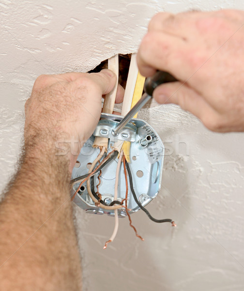 Electrician Attaching Ceiling Box Stock photo © lisafx