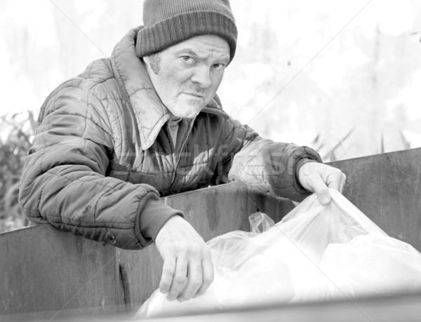 Hajléktalan férfi gyökerek szemeteskuka étel feketefehér Stock fotó © lisafx