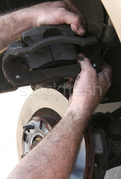 Nuevos freno mecánica manos hombres azul Foto stock © lisafx