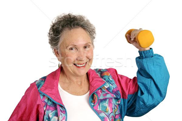 Starszy dopasować przyjazny uśmiechnięty kobieta dres Zdjęcia stock © lisafx