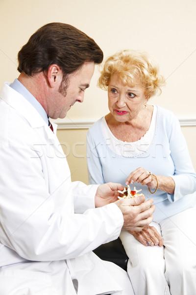 Starszy pacjenta kręgarz model kręgosłup leczenie Zdjęcia stock © lisafx