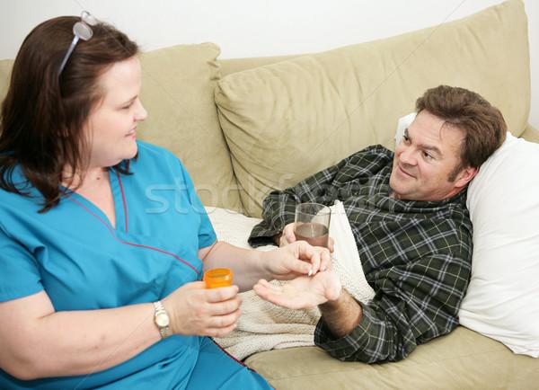 Otthon egészség gyógyszer egészségügy nővér tabletta Stock fotó © lisafx