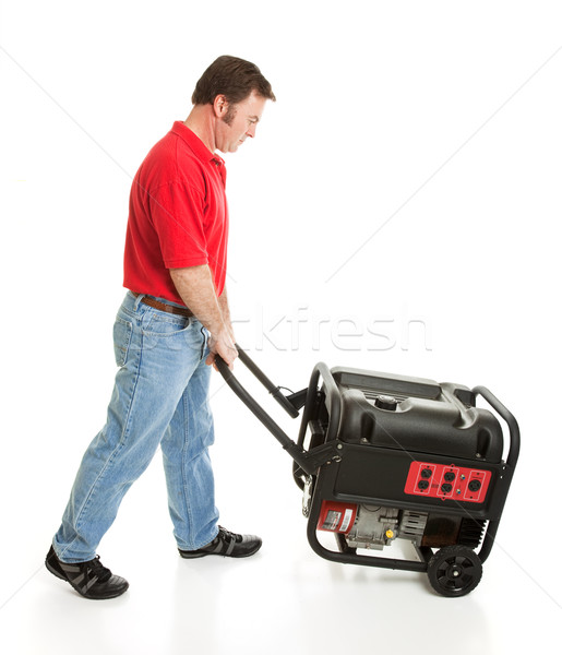 Homme poussant portable générateur électriques Photo stock © lisafx