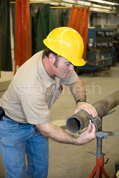 Metal Worker Measures Pipe Stock photo © lisafx