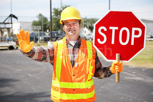 Stock photo: Construction Worker with Stop Sign