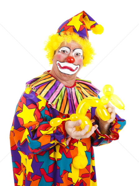 Disgusted Clown with Balloon Dog Stock photo © lisafx