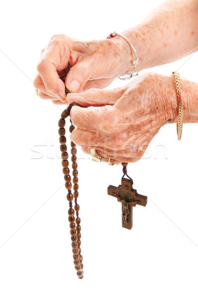 Rozenkrans kralen senior handen Stockfoto © lisafx