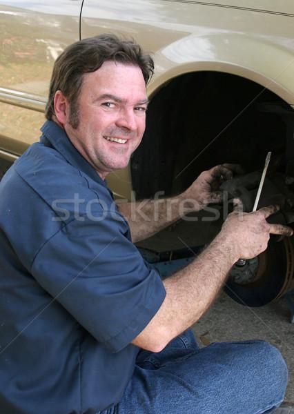 Güvenilir mekanik bakıyor tamir araba Stok fotoğraf © lisafx