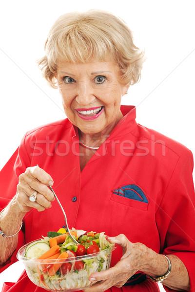 Senior Woman Eats Salad Stock photo © lisafx