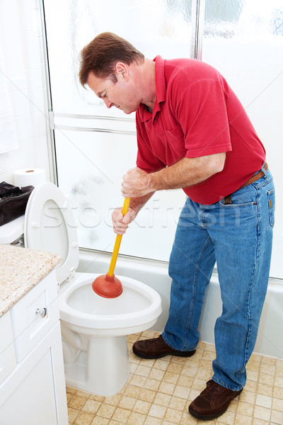 Man Plunging Toilet Stock photo © lisafx