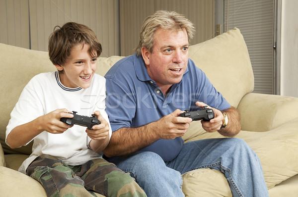 Man jongen spelen video games vader zoon oom Stockfoto © lisafx