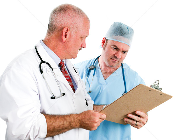 Doctors Review Patient Chart Stock photo © lisafx