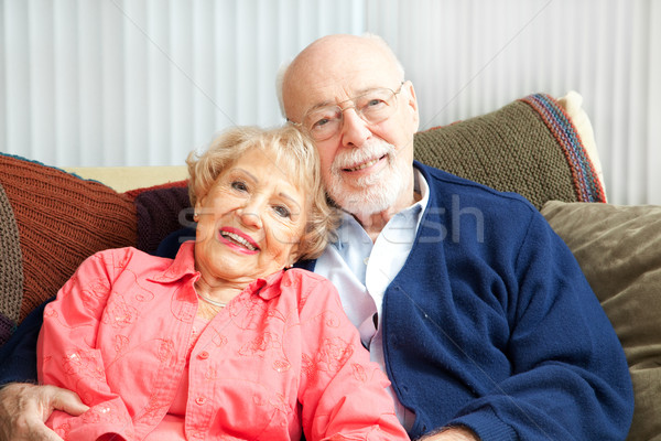 Stock photo: Senior Couple Relaxing on Couch