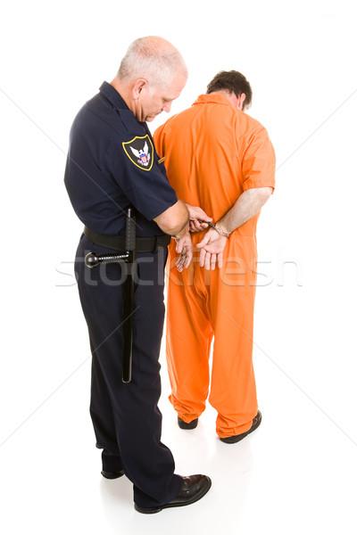 Poliziotto manette prigioniero poliziotto arancione isolato Foto d'archivio © lisafx