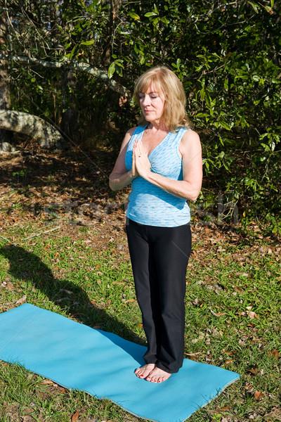 Starsza kobieta jogi oddychanie piękna sześćdziesiąt rok Zdjęcia stock © lisafx