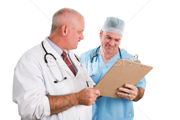 Male Medical Team Reviews Chart Stock photo © lisafx