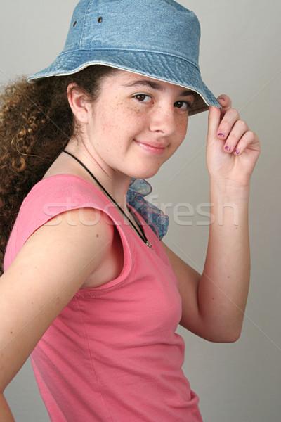Stylish Girl Tips Hat Stock photo © lisafx