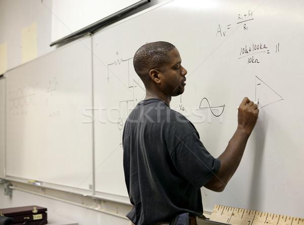 Zaawansowany matematyki student przystojny trygonometria pokładzie Zdjęcia stock © lisafx