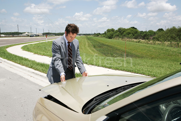 Stock photo: Businessman Checking Under Hood