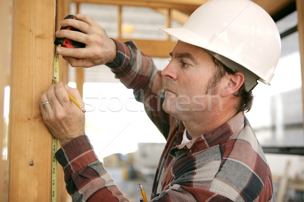 Construction Worker Takes Measurments Stock photo © lisafx