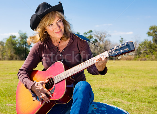 Cowgirl Plays a Tune Stock photo © lisafx