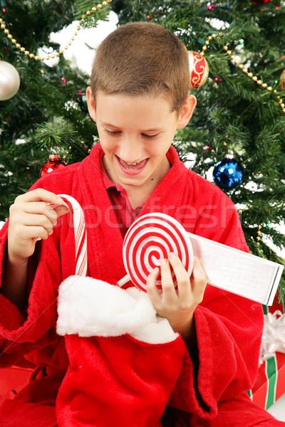 Piccolo ragazzo apertura Natale stocking cute Foto d'archivio © lisafx