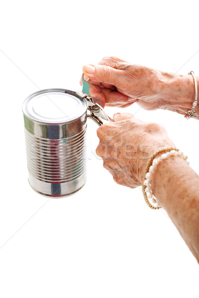 Elderly Hands Struggle with Can Opener Stock photo © lisafx