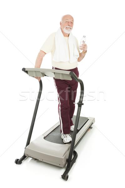 Senior homem saúde clube esteira água Foto stock © lisafx