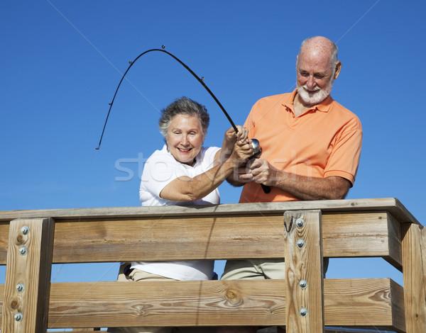 Seniors Reeling in a Big Fish Stock photo © lisafx