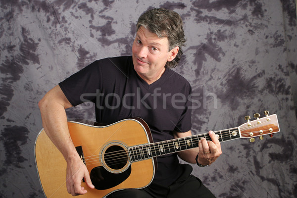 Handsome Musician Playing Guitar Stock photo © lisafx