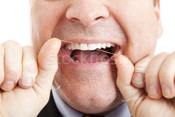 Dents homme soie dentaire sourire bouche Photo stock © lisafx