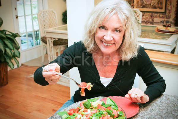 Sexy Senior Woman Eats Healthy Stock photo © lisafx