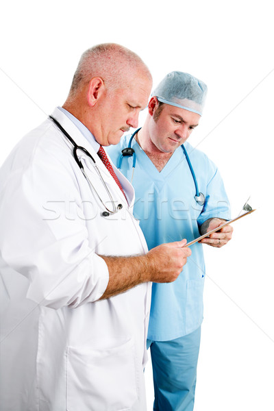Doctors Consulting Medical Record Stock photo © lisafx