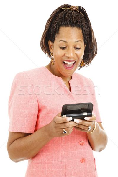 Businesswoman Reads Text Message Stock photo © lisafx