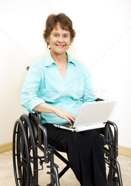 Disabled Woman with Netbook Stock photo © lisafx