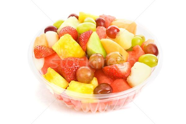 Salade de fruits bol coloré délicieux isolé blanche Photo stock © lisafx
