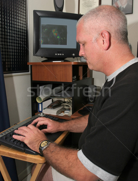 Meteorologist at the Computer Stock photo © lisafx