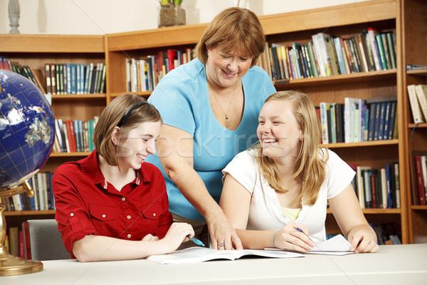 Barátságos tanár segít diákok könyvtáros tini Stock fotó © lisafx