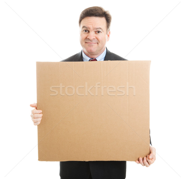 Embarrassed Businessman with Cardboard Sign Stock photo © lisafx