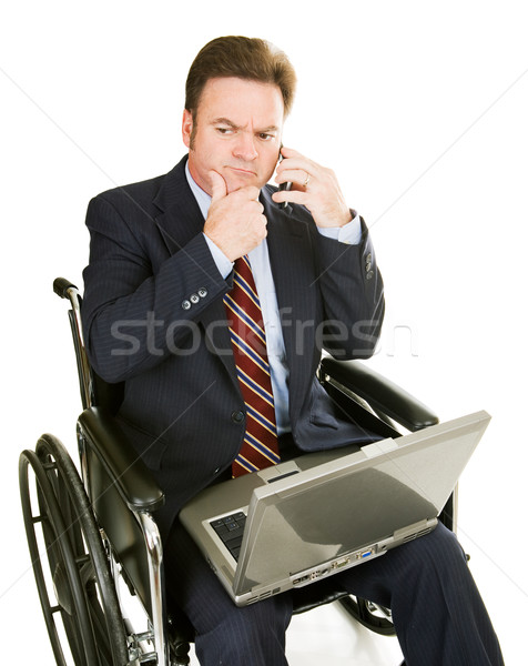 Disabled Businessman - Thinking Stock photo © lisafx