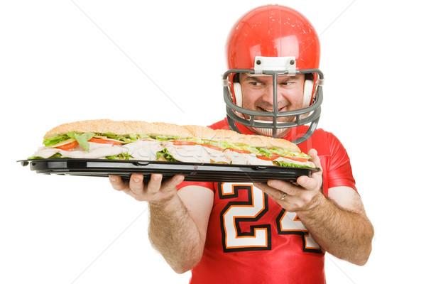 Férfi éhség futballista néz óriás tengeralattjáró Stock fotó © lisafx