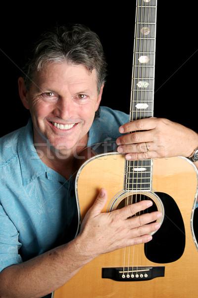 Músico guitarra guapo posando negro sexy Foto stock © lisafx