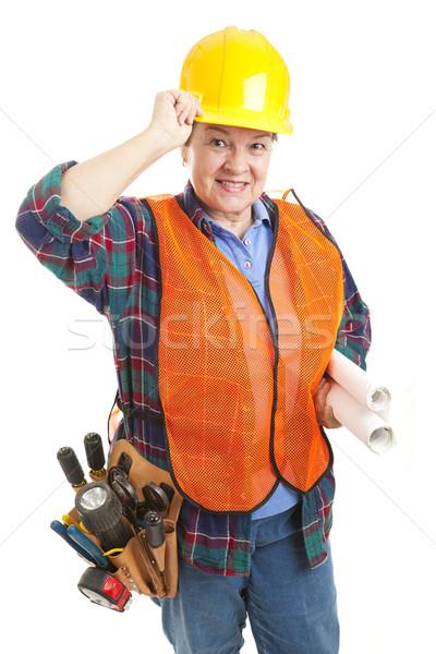 Beleefd vrouwelijke bouwvakker tips hoed geïsoleerd Stockfoto © lisafx
