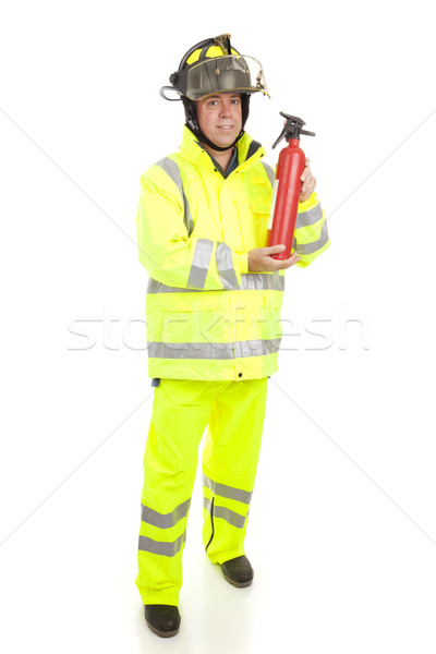 Stock photo: Fireman with Fire Extinguisher