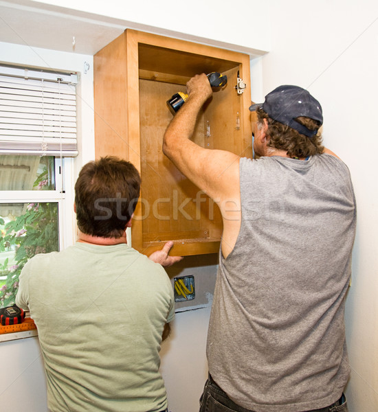 Installing Cabinets - Teamwork Stock photo © lisafx