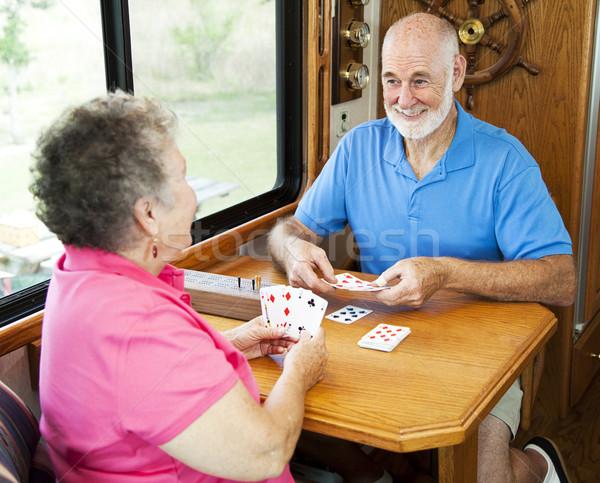 Idősek kártya játék idős pár vakációzás motor Stock fotó © lisafx
