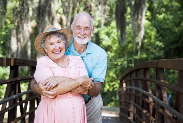 Romantic Seniors on Bridge Stock photo © lisafx